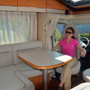 Woman in camper (RV) interior, family travel and vacation